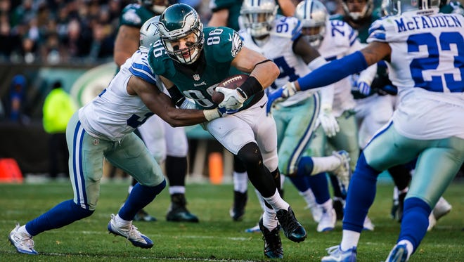 Eagles tight end Zach Ertz tries to break out of a tackle in the third quarter of the Philadelphia Eagles 27-13 win over the Dallas Cowboys at Lincoln Financial Field in Philadelphia, Pa. on Sunday afternoon.