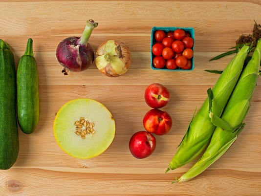 Clockwise, from top left: Zucchini, onions, cherry tomatoes, corn (2 of 6), nectarines (3 of 4) and a honeylope. Photo by Jeff Lautenberger.