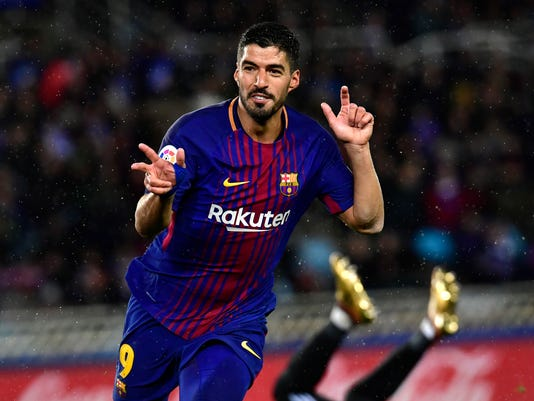 FC Barcelona's Luis Suarez, celebrates after scoring his second goal during the Spanish La Liga soccer match between Barcelona and Real Sociedad, at Anoeta stadium, in San Sebastian, northern Spain, Sunday, Jan.14, 2018. (AP Photo/Alvaro Barrientos)