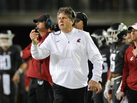 Washington State Cougars head coach Mike Leach looks