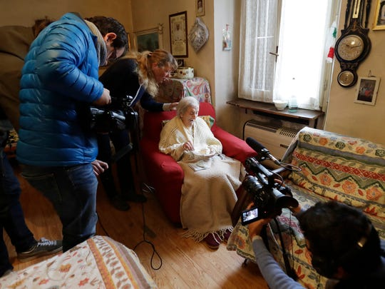 Emma Morano, 117 years hold,  is filmed as she eats cake in the day of her birthday in Verbania, Italy, Tuesday, Nov. 29, 2016.  At 117 years of age, Emma is now the oldest person in the world and is believed to be the last surviving person in the world who was born in the 1800s, coming into the world on Nov. 29, 1899.