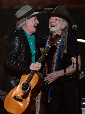 Keith Richards and Willie Nelson laugh on stage at the Merle Haggard Tribute concert at Bridgestone Arena Thursday, April 6, 2017 in Nashville, Tenn.