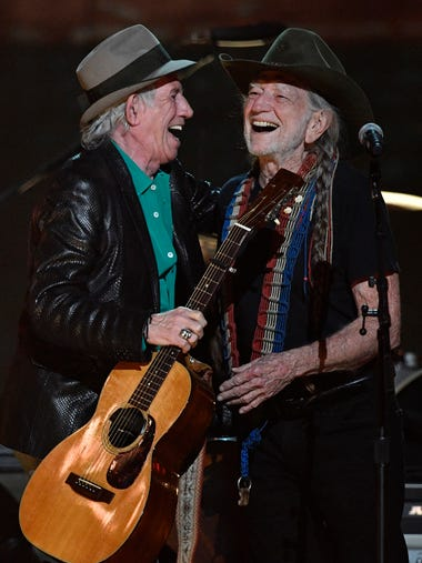 Keith Richards and Willie Nelson laugh on stage at