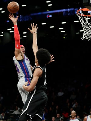 Detroit Pistons' Tobias Harris (34) shoots over Brooklyn Nets' Jarrett Allen (31) during the first half of an NBA basketball game Wednesday, Jan. 10, 2018, in New York.