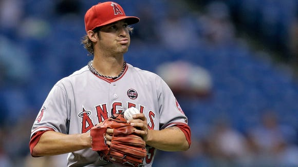 Los Angeles Angels starting pitcher C.J. Wilson reacts