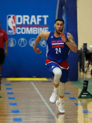 Denzel Valentine runs the three-quarter-court timed sprint at the NBA Combine Friday in Chicago.