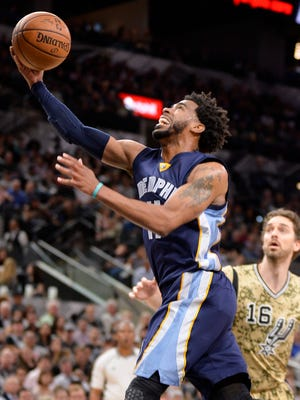 Memphis Grizzlies guard Mike Conley shoots during the first half of the team's NBA basketball game against the San Antonio Spurs, Thursday, March 23, 2017, in San Antonio.