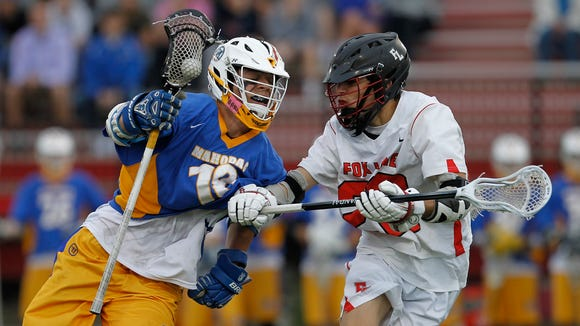 Mahopac's Andrew Evans (18) works against Fox Lane's Matt Harrison (22) during the class A quarterfinal boys lacrosse game  at Fox Lane High School in Bedford on Wednesday, May 18, 2016.