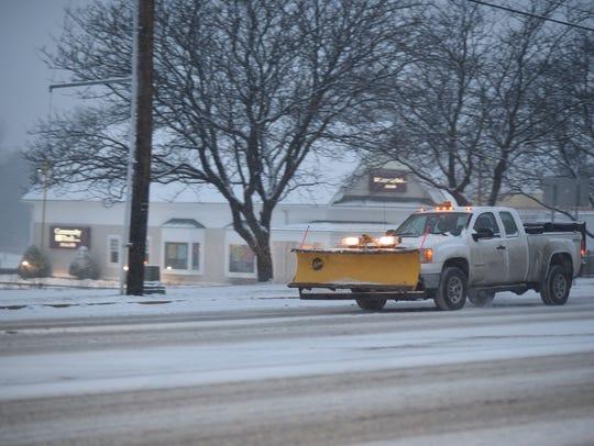 A snowplow heads south on Shelburne Road in South Burlington