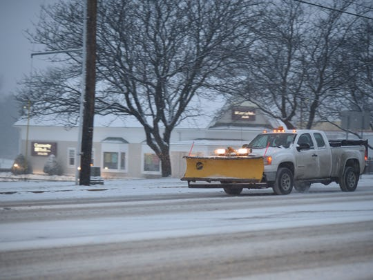 A snowplow heads south on Shelburne Road in South Burlington