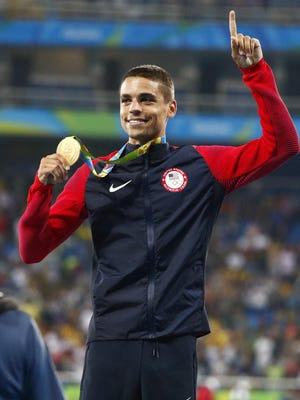 Matthew Centrowitz celebrates winning the gold medal in the men's 1500m event the Rio 2016 Summer Olympic Games at Estadio Olimpico Joao Havelange.