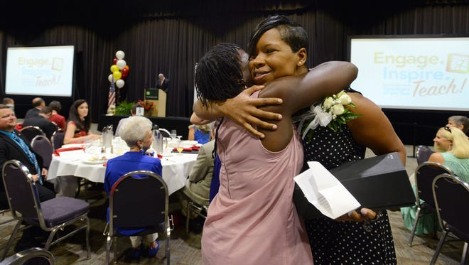 Shiree Turner Fowler, right, a kindergarten teacher at Hollis Elementary Academy, hugs Karen Lake after Fowler accepted awards for being Greenville County Teacher of the Year on Thursday, August 13, 2015.