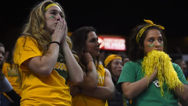 Bishop Manogue students watch as their team falls to Bishop Gorman for the NIAA boys basketball championship at Lawlor Events Center in Reno on Feb. 23, 2018.