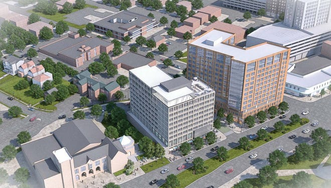 A rendering of the proposed apartment building and hotel at the corner of Grand River Avenue and Abbot Road in downtown East Lansing.