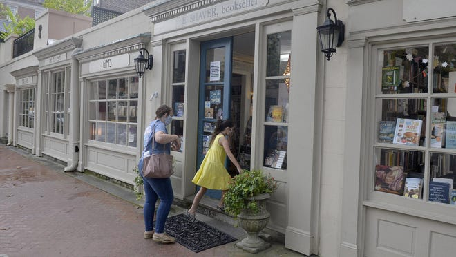Customers head into E. Shavers, Bookseller to shop last month. According to the Georgia Department of Labor, the state preliminary unemployment rate fell to 9.7% in May from 12.6% in April, a result of more businesses opening back up.