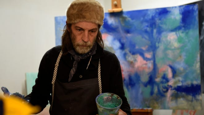 Jimmy Abegg paints in his studio Tuesday, Feb. 16, 2016, in Nashville. Abegg, a Nashville musician, photographer and painter, was recently diagnosed with macular degeneration. He can no longer practice photography or graphic design, but he can still see light, shapes and colors, which means he can still make his beautiful art.