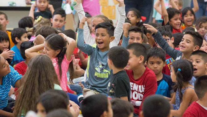Students at Univerity Hills cheered as the winners of the classes that read the most during the Scholastic Summer Reading Challenge were read at the end of the celebration for the school being named the New Mexico's top performing school in the Scholastic Summer Reading Challenge. Wednesday, October 18,2017.