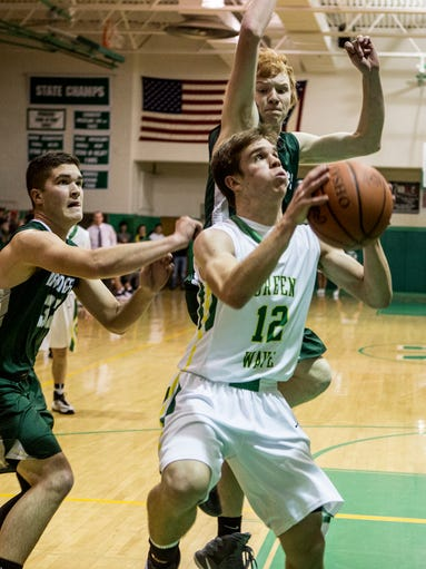Tanner Lake of Newark Catholic shoots the ball during