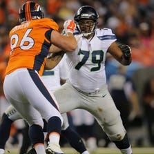 Tackle Garry Gilliam #79 of the Seattle Seahawks blocks against defensive tackle Mitch Unrein #96 of the Denver Broncos during preseason action at Sports Authority Field at Mile High on August 7, 2014 in Denver, Colorado. The Broncos defeated the Seahawks 21-16.  (Photo by Doug Pensinger/Getty Images)