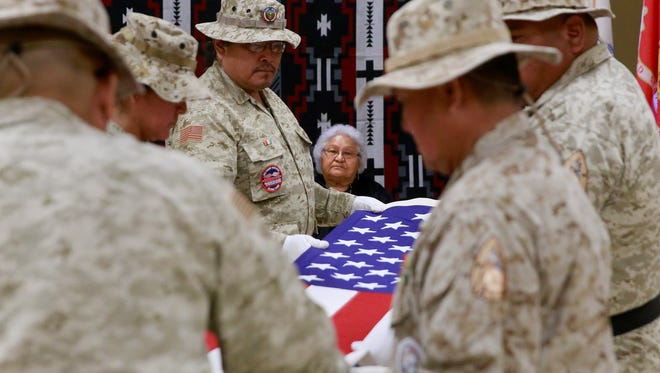 The Upper Fruitland Color Guard performs a Memorial Day flag folding ceremony for Joanne Benally in honor of her husband, Harrison Benally, a Navajo Code Talker, on May 30.