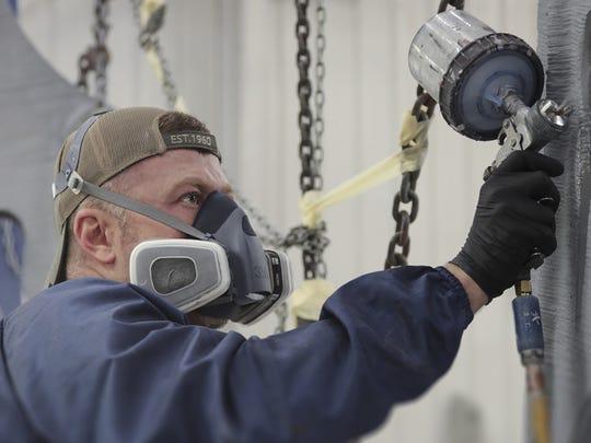 A worker at Oak Ridge National Laboratory works on