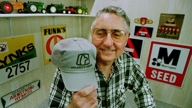 Williamsburg Mayor Murray Armstrong is shown in 1997 holding a seed-corn cap.
