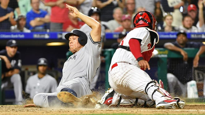 New York Yankees right fielder Aaron Judge (99) slides safely past Philadelphia Phillies catcher Jorge Alfaro (38) during the eighth inning at Citizens Bank Park. Mandatory Credit: Eric Hartline-USA TODAY Sports