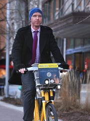 Garth Brazelton rides from his home Downtown to work