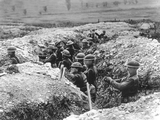 U.S. Army troops stand in the trenches in France during World War I.