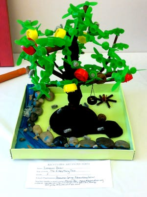 """Judges Shelley Knouse, Tai-Yin Landis and Laura Mares selected a work titled, """"The Everything Tree,"""" by Bermudian second-grader Dempsey Bodan as Best of Show for the Adams County Arts Council's 21st Annual Recyclable Art Contest and Exhibit for students in grades K-12."""