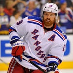 Center Brad Richards accepted a one-year, $2 million because the Chicago Blackhawks didn't have much cap room.