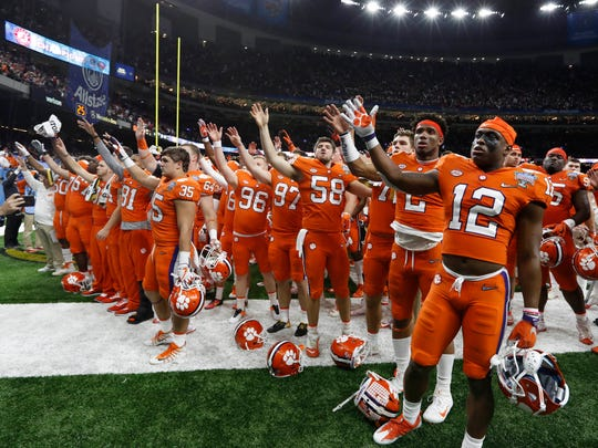 The Clemson Tigers react after a loss to the Alabama