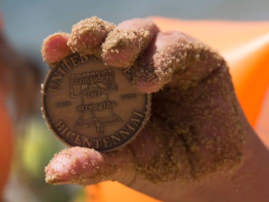 Scarlett Valerio shows off her commemorative coin she
