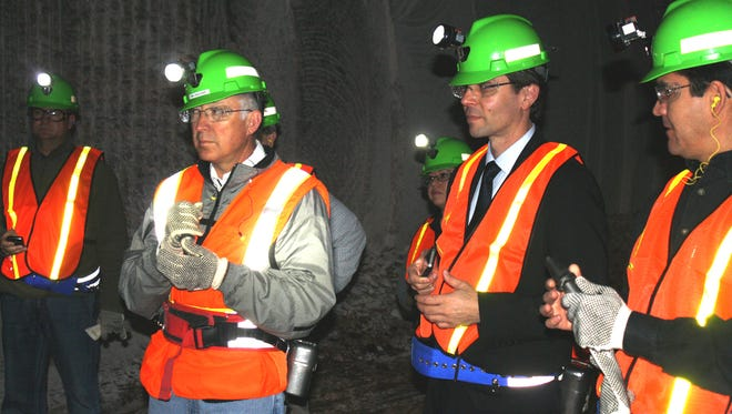In this file photo from 2012, U.S. Secretary of the Interior Ken Salazar (left) and Greg Bloom, state director for Sen. Jeff Bingaman's, D-NM, look on as a driller exposes 280-million-year-old rock in Mosaic Potash's Number 5 shaft. Salazar, Bingaman and Bureau of Land Management Director Bob Abbey toured the mine before participating in a Potash, Oil and Gas Steering Committee meeting.