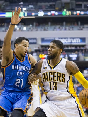 Paul George of Indiana works against Andre Roberson of Oklahoma City Thunder at Indiana Pacers, Bankers Life Fieldhouse, Indianapolis, Monday, February 6, 2017.