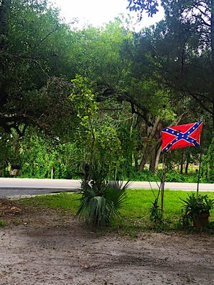 Everett Booth has been flying the Confederate flag in Buckingham for decades and has no plans to take it down.
