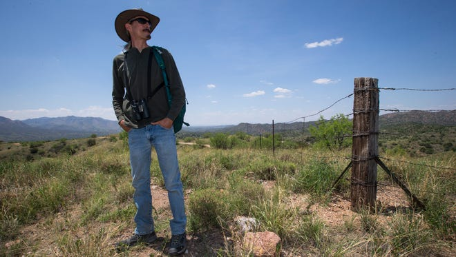 Randy Serraglio, with the Center for Biological Diversity in Tucson, stands in an area above the town of Patagoinia, not far from the site of the proposed Rosemont Copper mine, on Thursday, July 24, 2014. Serraglio and other environmentalists are actively fighting the mine, saying it will adversely affect aquifers that fulfill 20 percent of Tucson's water supply.