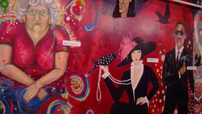 "A wall in the ""PaintPeopleProject"" in Amy Burnett's downtown gallery."