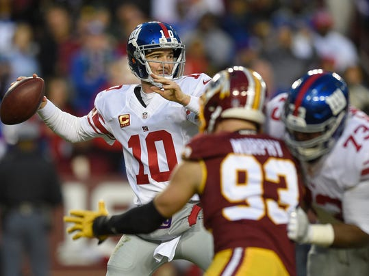 New York Giants quarterback Eli Manning (10) passes the pass against the Washington Redskins during the first half of an NFL football game in Landover, Md., Sunday, Jan. 1, 2017. (AP Photo/Nick Wass)