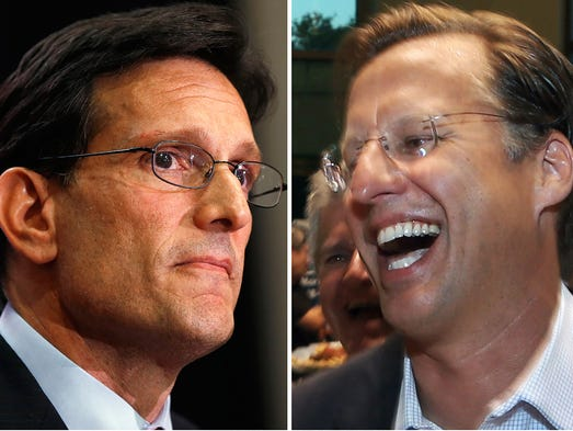 House Majority Leader Eric Cantor, R-Va., left, and Dave Brat, right, react after the polls closed June 10 in Richmond, Va. Tea Party candidate Brat defeated Cantor in the Republican primary.