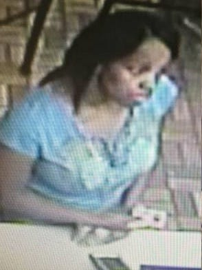 Have you seen this woman? Police say she purchased $800 in gift cards at a Burger King with a fraudulent credit card.