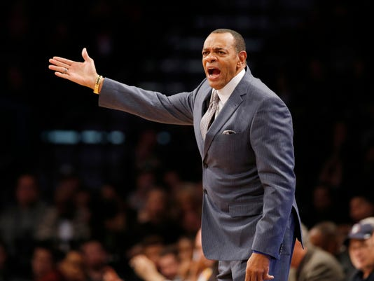 Brooklyn Nets head coach Lionel Hollins shouts at the referee in the first half of an NBA basketball game, Sunday, Nov. 29, 2015, in New York. (AP Photo/Kathy Willens)