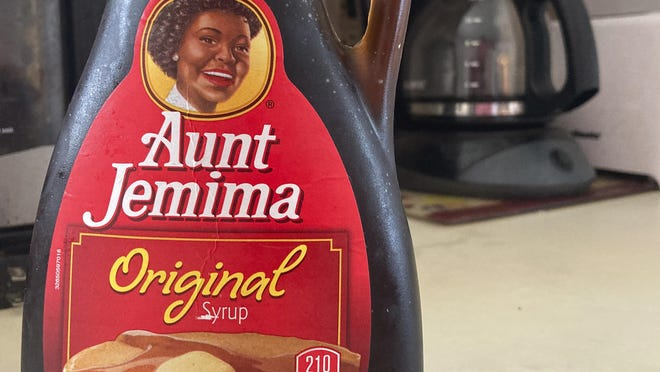 A bottle of Aunt Jemima syrup sits on a counter, Wednesday, June 17, 2020 in White Plains, N.Y.  Pepsico is changing the name and marketing image of its Aunt Jemima pancake mix and syrup, according to media reports. A spokeswoman for Pepsico-owned Quaker Oats Company told AdWeek that it recognized Aunt Jemima's origins are based on a racial stereotype and that the 131-year-old name and image would be replaced on products and advertising by the fourth quarter of 2020.