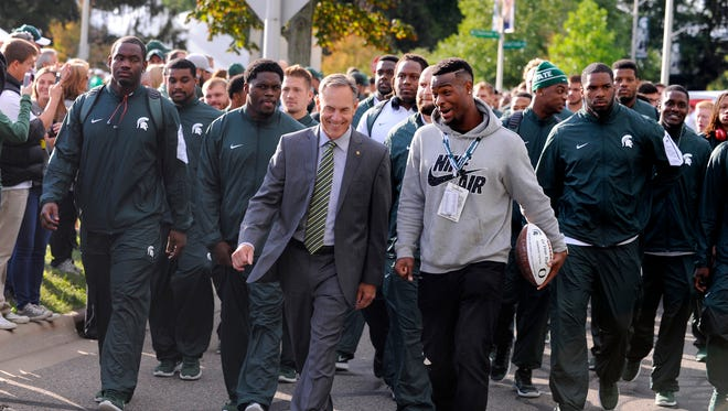 MSU coach Mark Dantonio and former star Le'Veon Bell, lead the Spartans to the Stadium before their game against Oregon in 2015. The crux of that team came from from a 2011 recruiting class that wasn't all that heralded. Bell showed up a year earlier in 2010. Those two classes were largely responsible for MSU's 36-5 run from 2013-15.