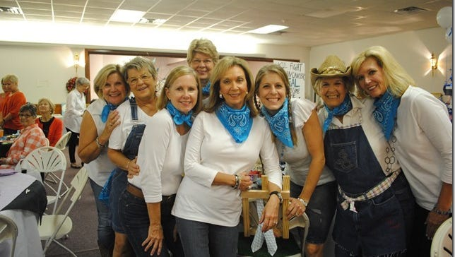 The Teal Table winners, also voted People's Choice, from left to right, are Beth Mewborn, Pat Harper, Druann Williams, Sandra Baker, Jackie Palmer, Leigh Scroggs, Tammy Hutchinson and Sarah Scroggs.