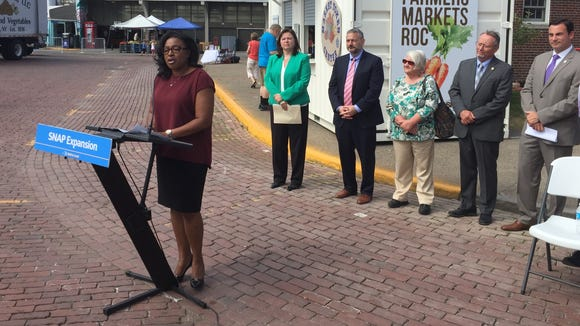 Mayor Lovely Warren praises a decision to expand eligibility for food stamps.