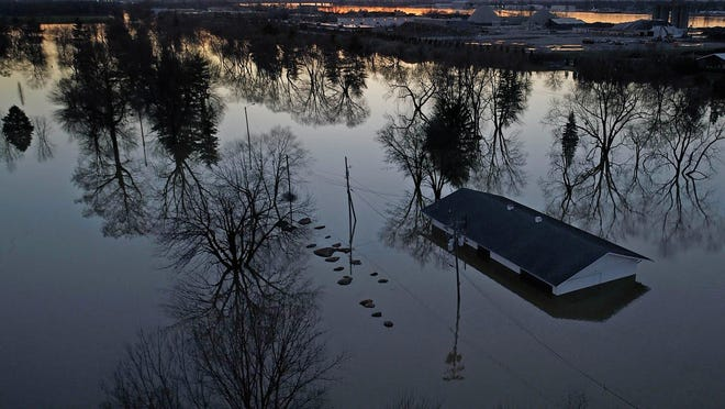 A drone photograph showing a structure submerged by flood waters west of Zorn Aveune and River Road on Feb 26, 2018 in Louisville, Kentucky. Substantial rain has caused severe flooding in the Louisville area. [Mike De Sisti and Scott Clause/USA TODAY Network]Usp News Flooding A Usa Ky