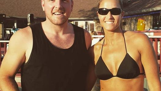 Christie Stanifer (right) grabbed a photo with Colts punter Pat McAfee, who had a quick sand volleyball practice session at Midwest Sports and Social Complex Monday.