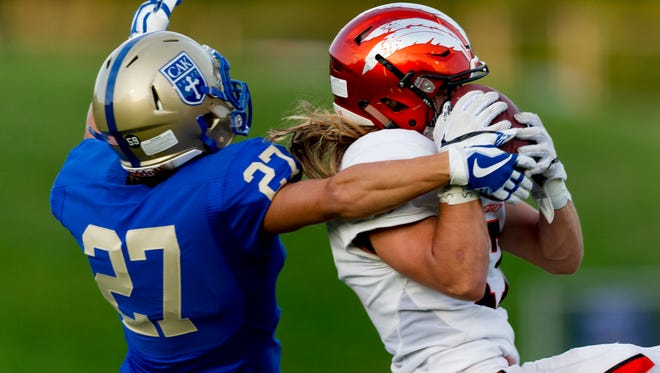 Greenback's Cole Riddle (17) intercepts a pass intended for CAK's Luke Slaughter (27).