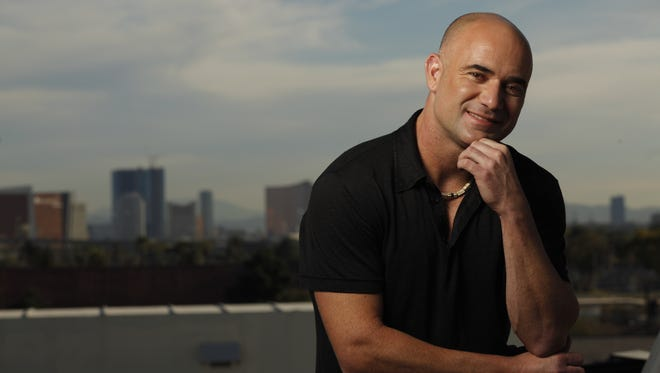 Andre Agassi poses with the Las Vegas skyline in the bacground on the top of the Andre Agassi College Prepatory Academy in Las Vegas.
